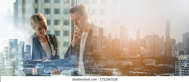 Double exposure of Meeting and discussion concept.business people communicating in office.Mature businessman discuss information with a colleague in a modern business lounge high up in an office tower