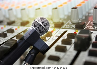 Double exposure of microphone in concert hall or conference room
