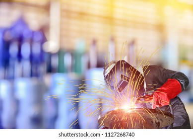 Double exposure Mig welding Workers on steel used to weld with electric welding machine on steel pipe system comcept, power cord and safety equipment.