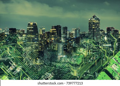 Double exposure of modern cityscape and electric circuit.