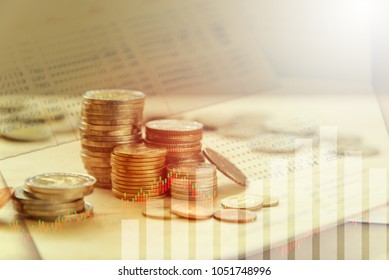 Double exposure of Money coins stack, book bank, graph  finance, business concept