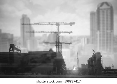 Double exposure monochrome construction industry building. for project estate economy investment concept.