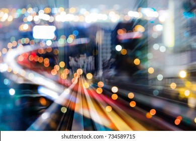 Double exposure moving train over blurred bokeh city light night view, abstract background
