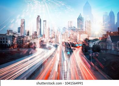 Double exposure of night traffic in modern big city, Atlanta, GA, USA