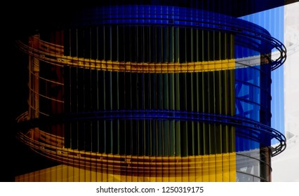Double exposure of office building interior fragment with louvered windows revealed cylinder-like structure. Abstract background on the subject of modern architecture, interior or technology.