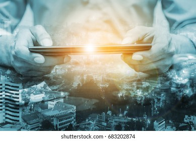 Double exposure online banking and internet banking and people networking account banking finance concept, Business man with laptop and city land flare style
