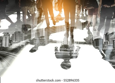 Double exposure of people walking and cityscape representing urban life.