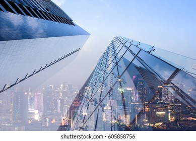 Double exposure of perspective low angle view luxury modern buildings and the city can use for business and finance background