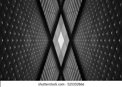 Double exposure photo of sloped walls. Realistic though unreal office interior fragment. Abstract black and white image on the subject of modern architecture.