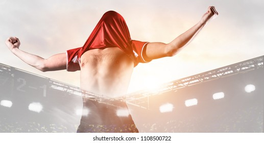double exposure photo of stadium and soccer or football player celebrating goal with his jersey on head