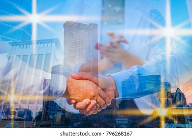 Double exposure picture. Picture mix  building city and businessman is Shake hands show Confident. Picture concept action man and business .