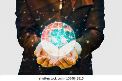 Double exposure- polygon and dot line technology businessman uses hands embrace world with energy bursting to energize spirits of life with glittering lights,Elements of this image furnished by NASA