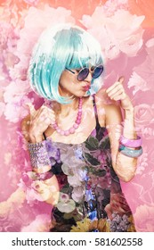 Double exposure of pop girl with thumbs up and flowers