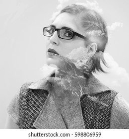 double exposure portrait of attractive beautiful young woman - analog black and white film filter with noise