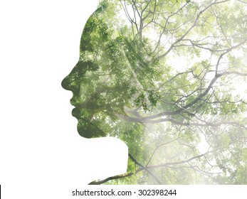 Double exposure portrait of attractive lady combined with photograph of tree. Be creative!