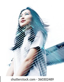 Double exposure portrait with beautiful Asian business woman and modern skyscraper