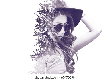 Double exposure portrait of beautiful girl combined with photograph of tree. retro tone