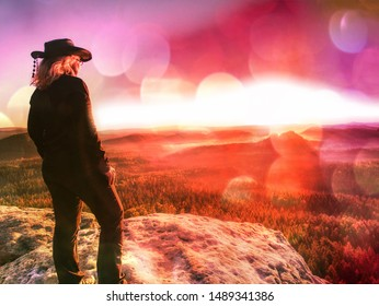 Double exposure portrait of business woman wear cowboy hat  and sunset on peak.  Abstract filter.