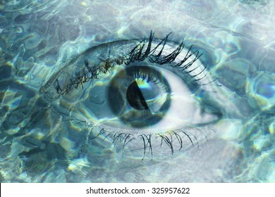 Double exposure portrait of macro eye combined with photograph of water. Be creative!