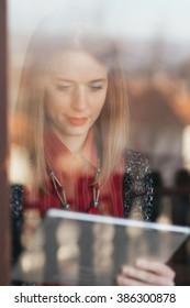 Double exposure portrait ...Woman using tablet ...