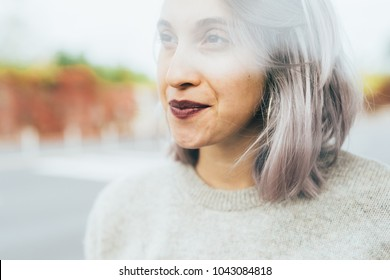 Double exposure portrait of young beautiful caucasian purple grey hair woman outdoor looking away smiling - serene, carefree, positive emotions concept