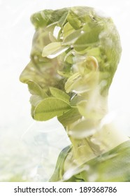 Double exposure portrait of young man and green leaves