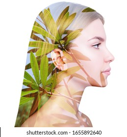 Double exposure portrait of young woman and branches. Over white background.