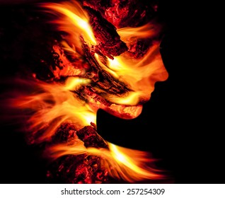 Double exposure portrait of young woman and fire.