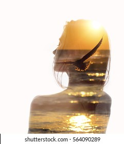 Double exposure portrait of a young woman combined with photograph of flying bird in sunset reflecting in ocean. Conceptual image showing unity of human with nature. Ecology, freedom, environment