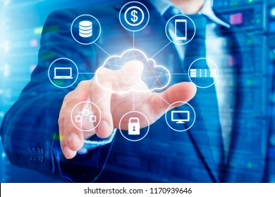 Double exposure of professional businessman connected devices with Cloud technology internet and wireless network on touch screen and city of business background in business and technology concept