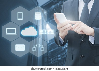 Double exposure of professional businessman connecting cloud internet smart phone with servers technology and connect world network in IT Business concept