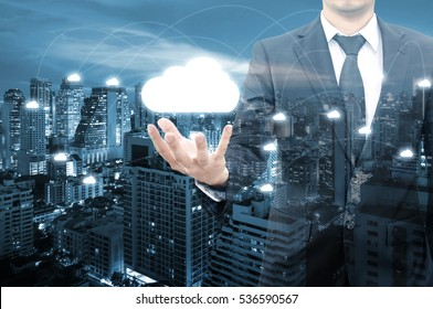 Double exposure of professional businessman connecting internet with cloud technology and connect world network in IT Business and Communication concept
