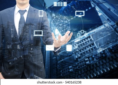 Double exposure of professional businessman connecting network on hand in Cloud technology, communication and business concept