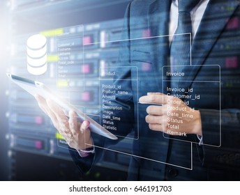 Double exposure of professional businessman connecting database with tablet devices on hand in Cloud technology and business concept