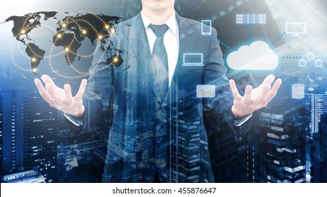 Double exposure of professional businessman holding wolrd network connection and cloud technology with cityscape in business and technology concept, element of this image furnished by NASA