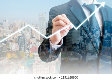 Double exposure of professional businessman with night cityscape drawing growth graph in business concept