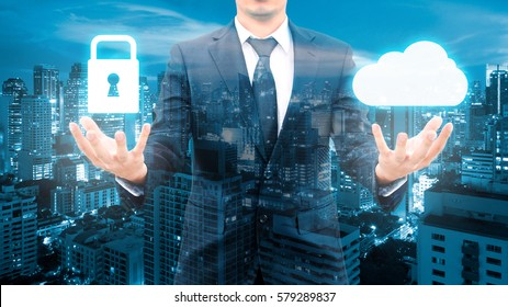 Double exposure of professional businessman security protection and cloud network connection technology with cityscape in communication , business and security technology concept