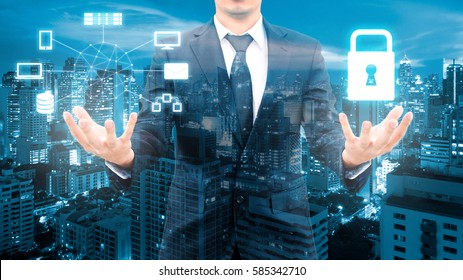 Double exposure of professional businessman security technology protection and network connection with blurred cityscape in communication , technology and business concept