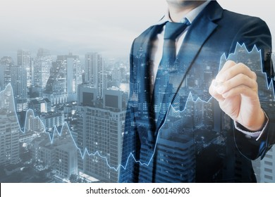 Double exposure of professional businessman touch financial graph and city of business in trading business and technology background;