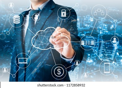 Double exposure of Professional businessman touching virtual screen on a digital interface to connected cloud computing with network devices & services , business and technology concept