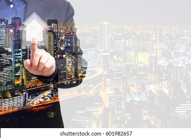 Double exposure property and real estate concept - businessman touching on house symbol and blank space