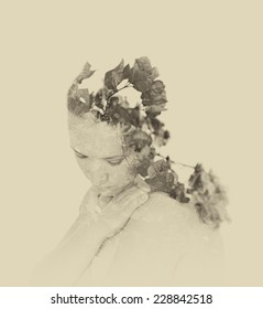 Double exposure of red flowers in the beautiful young woman. black and white image, vintage effect