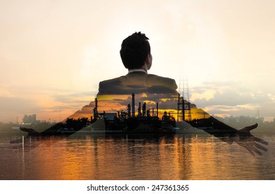 Double exposure of refinery oil and gas background, and businessman with business concept.