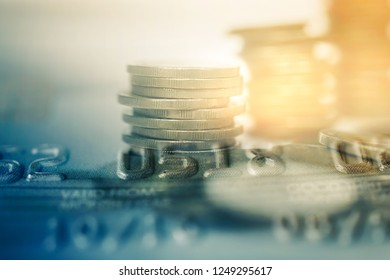 double exposure of row of coins  and credit card  for business and finance background