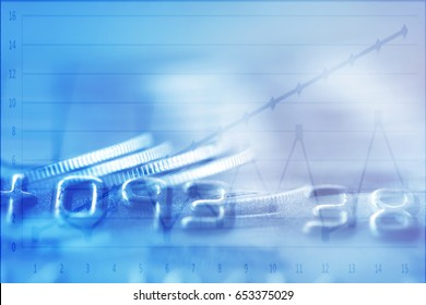 Double exposure Rows of coins of Credit cards and graph on the table,finance and business concept,Money,soft focus and blurred style,dark tone.
