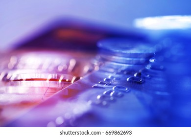 Double exposure Rows of coins of Credit cards on the table,finance and business concept,Money,soft focus and blurred style,dark tone.