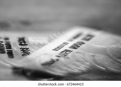 Double exposure Rows of coins of Credit cards on the table,finance and business concept,Money,soft focus and blurred style,black and white tone.