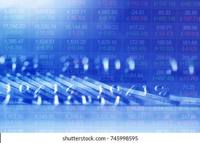 Double exposure Rows of coins of Credit cards and Graph on the table,finance and business concept,Money,soft focus and blurred style,tone tone.