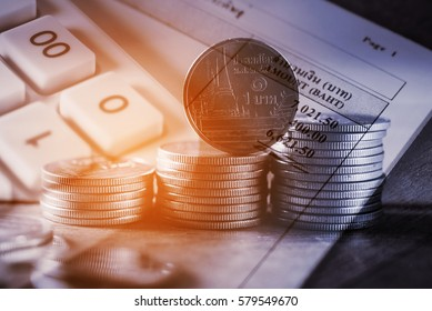 Double exposure rows of coins with utility bill and calculator and account banking for finance concept, Save money concept