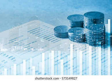 double exposure of rows of coins,city,graph and account book in finance and banking concept